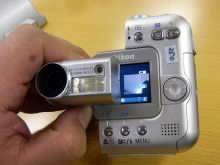 Digitální fotoaparát Nikon CoolpixSQ v chodu